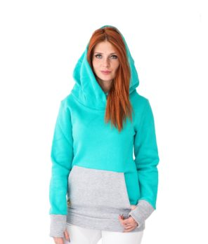 Patricia wearing surf hoodie bombora in ocean colour shown from the front