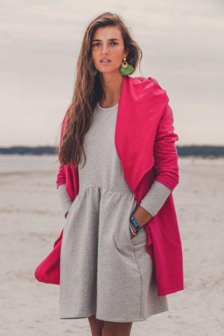 Kamila Szczawińska wearing Evokaii Aloha Surf Coat on the Baltic Sea Side Beach
