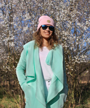 Surf Girl Wearing Aloha Surf Coat in Spring with pink beanie hat