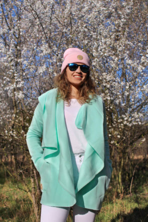 Surf Girl Wearing Aloha Surf Coat in Snow Beanie Hat
