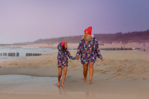 Mum and son walking beach in surf hoodie kangoo oversized hoodies.