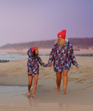 Mum and son walking beach in surf hoodie kangoo oversized hoodies.