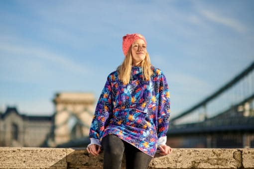 Surf girl in Budapest enjoying sunshine in oversized flower hoodie.