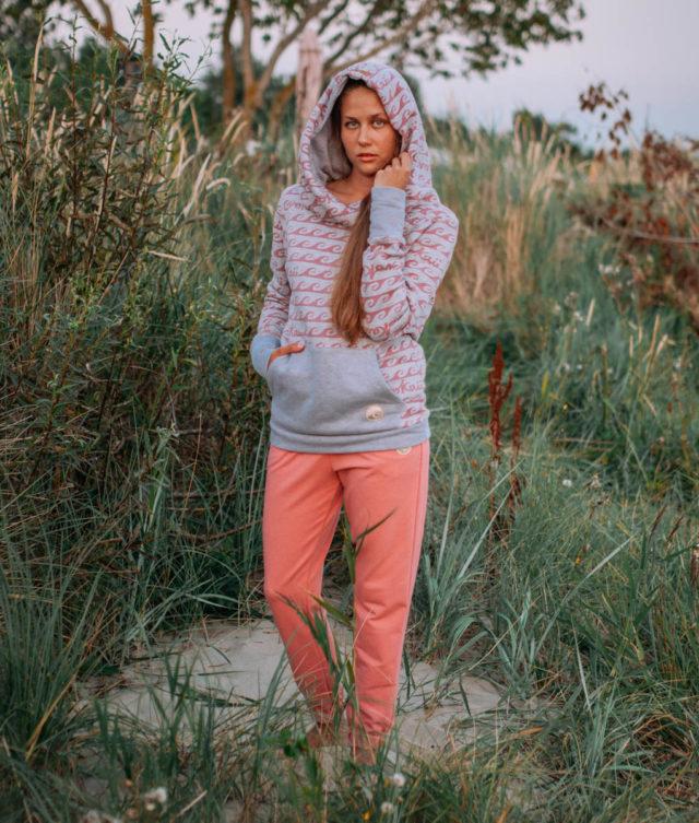 Surf girl wearing surf hoodie bombora at the baltic sea
