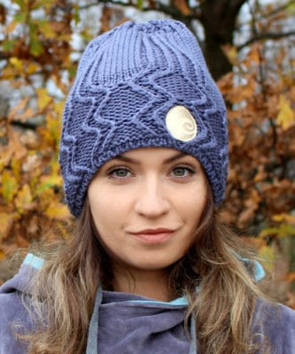 Surf girl wearing Anthracite surf beanie knitted hat in Autumn forest.