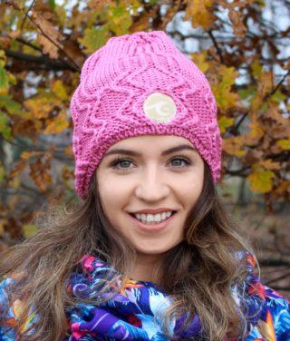 Surf girl wearing dark rose knitted beanie hat in Autumn forest.