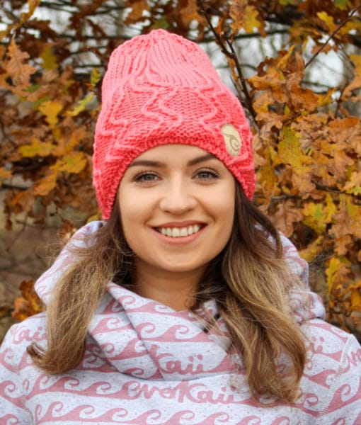 Surf girl beanie hat knitted with polar inside standing in the autumn forest.